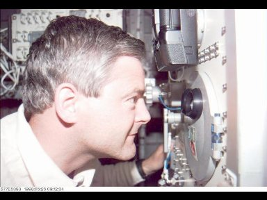 Astronaut Marc Garneau, mission specialist representing the Canadian Space Agency (CSA), makes a visual check of the Commercial Float Zone Furnace (CFZF).