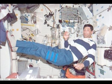 Astronaut Mario Runco, Jr., mission specialist, takes a break from activities on Space Shuttle Endeavours mid-deck.