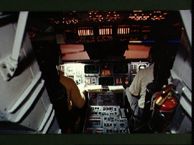 Astronaut Richard Truly and Candidate Frederick Hauck in shuttle simulator