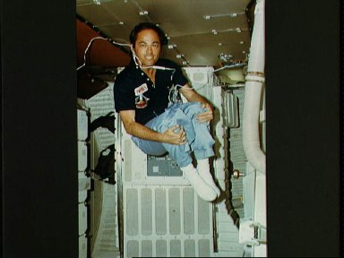 Inflight activites of Young and Crippen in the cockpit and middeck STS-1