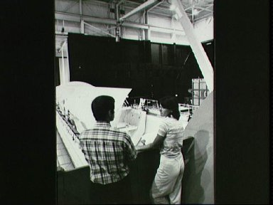 Astronauts Sally Ride and Terry Hart prepare for RMS training for STS-2