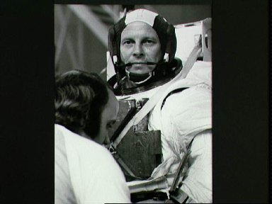 View of astronaut Jack Lousma in the Shuttle spacesuits (EMU) at bldg 29