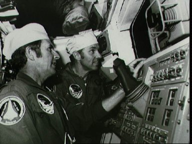 Astronauts Truly and Engle checking RMS instrument in cabin of Columbia