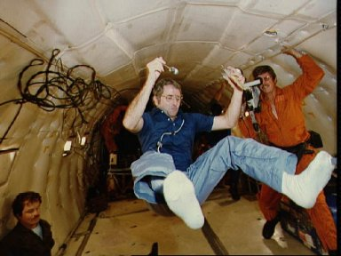 Astronaut Richard H. Truly gets practice eating in weghtlessness