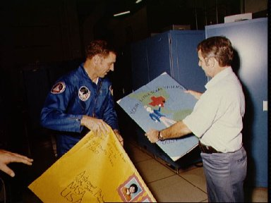 Astronauts Truly and Engle hold birthday remembrances made for Truly