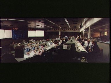 Wide angle view of overall activity in Mission Operations Control Room