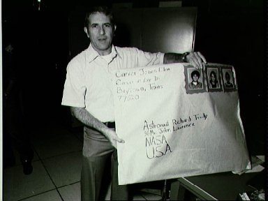 Astronaut Richard H. Truly holds a birthday card made for him