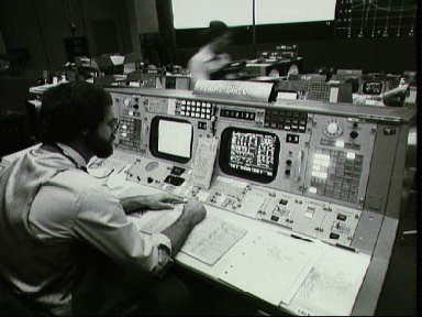 Documentary views of Flight Director and Controller activity during STS-2