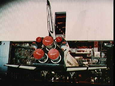 Orbiter Columbia is backed out of the OPF to begin rollover to the VAB STS-3