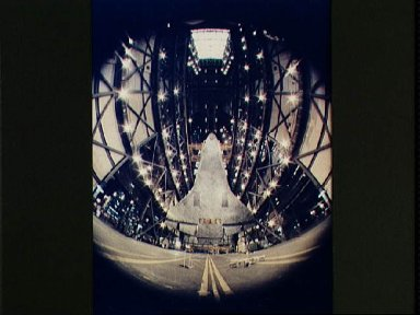 Fisheye view of the Columbia being lifted above the floor of the VAB