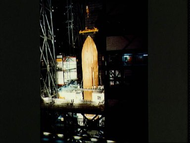 Erection of the STS-3 external tank (ET) in the VAB Hi-Bay #3 area 01-05-82