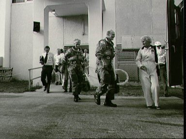STS-4 suited astronauts entering transfer van for trip to pad 39A for CDDT