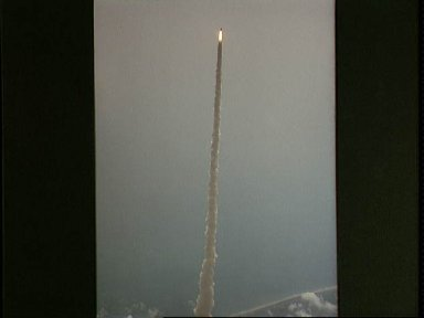 Air to air views of the STS-4 launch from pad 39A on June 27, 1982