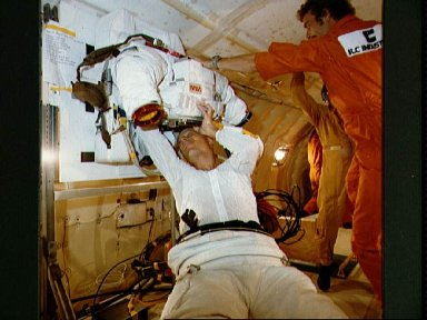 Spacsuit donning and doffing in zero-g training for Story Musgrave STS-6
