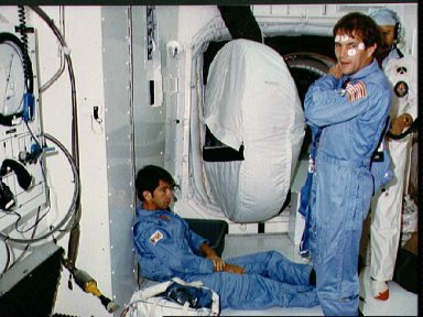 Astronaut Joseph P. Allen, STS-5 crew member, in front of open hatch