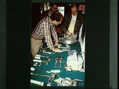 Astronaut Norman E. Thagard is briefed on array of tools for EVA