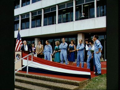 View of the STS-7 crew in front of bldg 1 after return from KSC