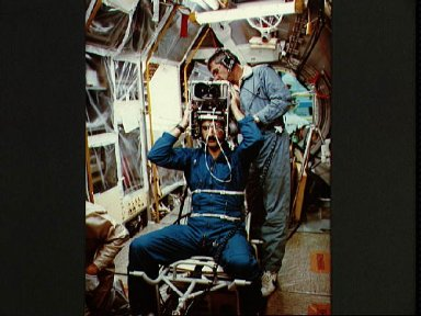 Backup payload specialist Ockels fitted with Spacelab mission experiment