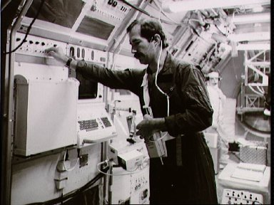 Payload specialist Ockels tests a strapon communications transceiver