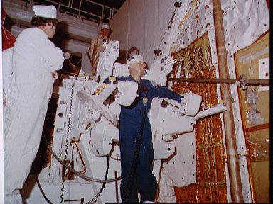 Astronaut McCandless checking fit of the MMU after installation in Challenger