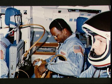 Astronauts McNair and Stewart prepare for reentry