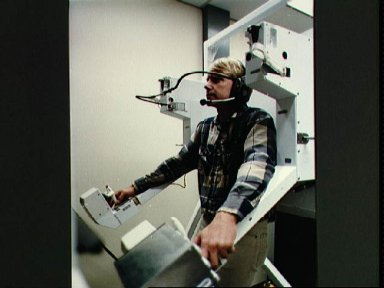 Astronaut George Nelson uses one-G version of MMU to prepare for EVA