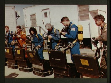 Space shuttle mission 41-D crew participates in fire training exercises