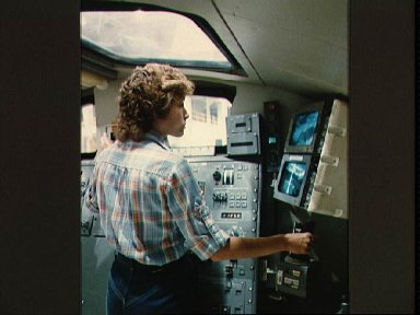 Astronaut Anna Fisher practices control of the RMS in a trainer