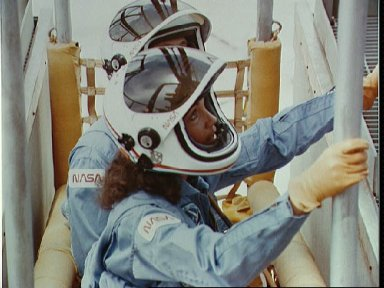 """Astronaut Judith Resnik in the """"basket"""" portion of the slidewire system"""
