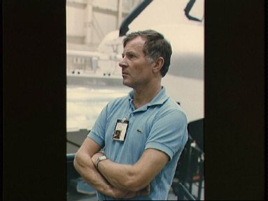 French mission specialist Jean Loup Chretien listens to briefing at mock-up