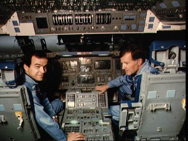 Payload specialists Baudry and Chretien in the Shuttle full fuselage trainer