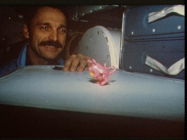 51-D astronauts Griggs and Hoffman with toys for use in Toys in Space Project