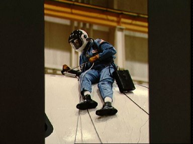 Mission specialist Shannon W. Lucid descends from crew compartment trainer