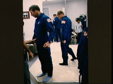 STS-26 Mission Specialists Hilmers and Nelson during wardrobe fitting