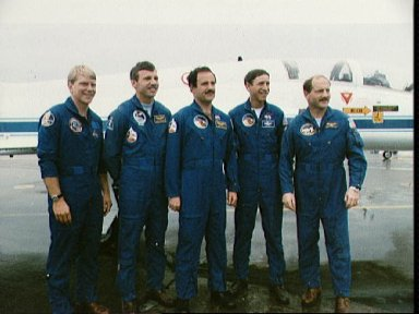 STS-26 crew poses for group portrait at Ellington Field prior to departure