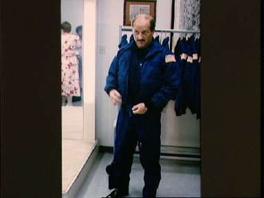STS-26 Commander Hauck zips jacket during wardrobe fitting