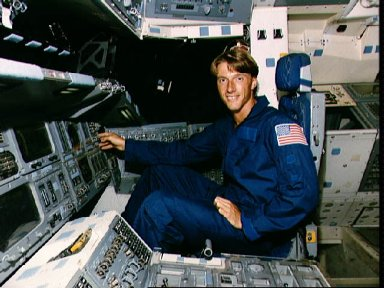 Group 12, 1987 ASCAN C. Michael Foale sits at the pilots station in JSC's FFT