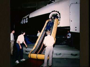 STS-26 MS Hilmers during egress training at JSC's MAIL full fuselage trainer