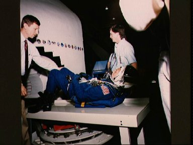 STS-26 crew trains in JSC crew compartment trainer (CCT) shuttle mockup