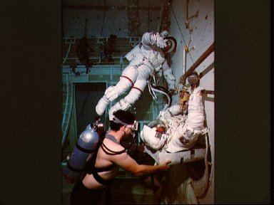 STS-26 mission specialists participate in EVA simulation in JSC's WETF