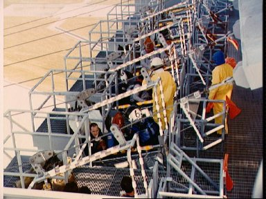 STS-26 crew during emergency egress exercise at launch pad 195 ft level