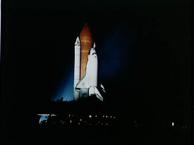 STS-26 Discovery, OV-103, rolls out toward KSC LC pad 39B during the night
