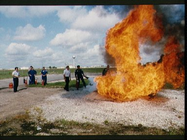 STS-27 crewmembers participate in fire fighting training at JSC
