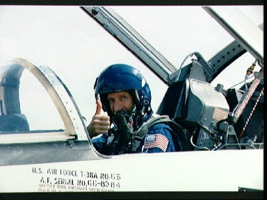 """STS-26 Pilot Covey gives """"thumbs up"""" from T-38 forward cockpit"""