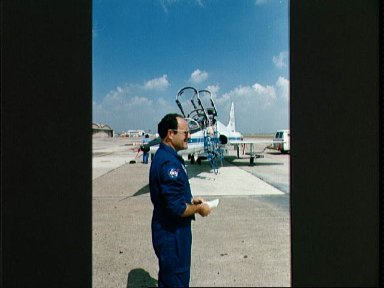 STS-26 Mission Specialist Lounge in front of T-38 on Ellington Field runway