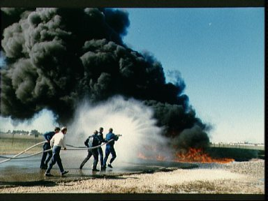 STS-29 crewmembers participate in fire fighting training at JSC