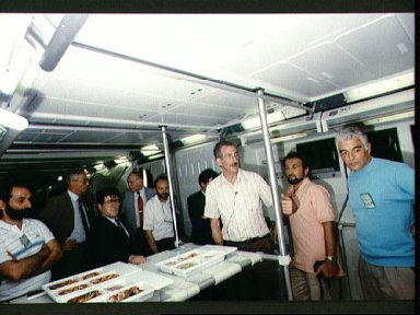 STS-46 MS Hoffman takes Italian Space Agency (ASI) personnel on tour of JSC