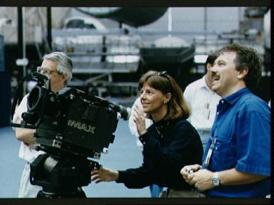 STS-32 Mission Specialist (MS) Dunbar uses IMAX camera during training