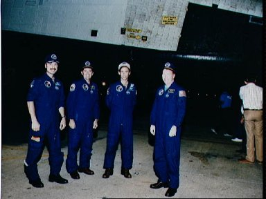 STS-28 crewmembers stand beside OV-102 during its rollover at KSC