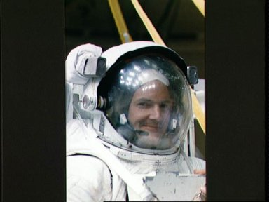 STS-32 MS Low fully suited in EMU with helmet prepares for WETF exercises